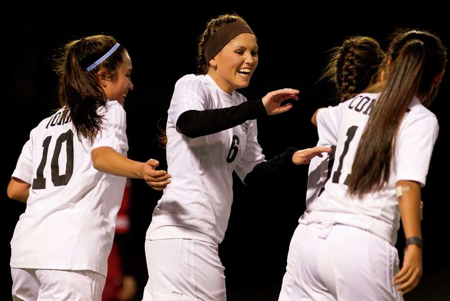 Conroe players celebrate with Brianna Peake (6) after her unassisted corner kick goal during the second period of a non-district high school girls soccer match at Buddy Moorhead Stadium Friday, Jan. 27, 2017, in Conroe. Conroe defeated Stafford 7-0. Photo: Jason Fochtman, Staff Photographer / © 2017 Houston Chronicle