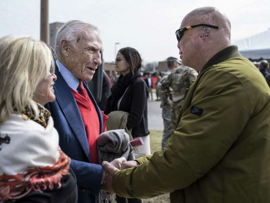 Arnold Fisher, the Intrepid Fallen Heroes Fund's honorary chairman (second from left), speaks with Shilo Harris. Photo: Matthew Busch / For The San Antonio Express-News / © Matthew Busch