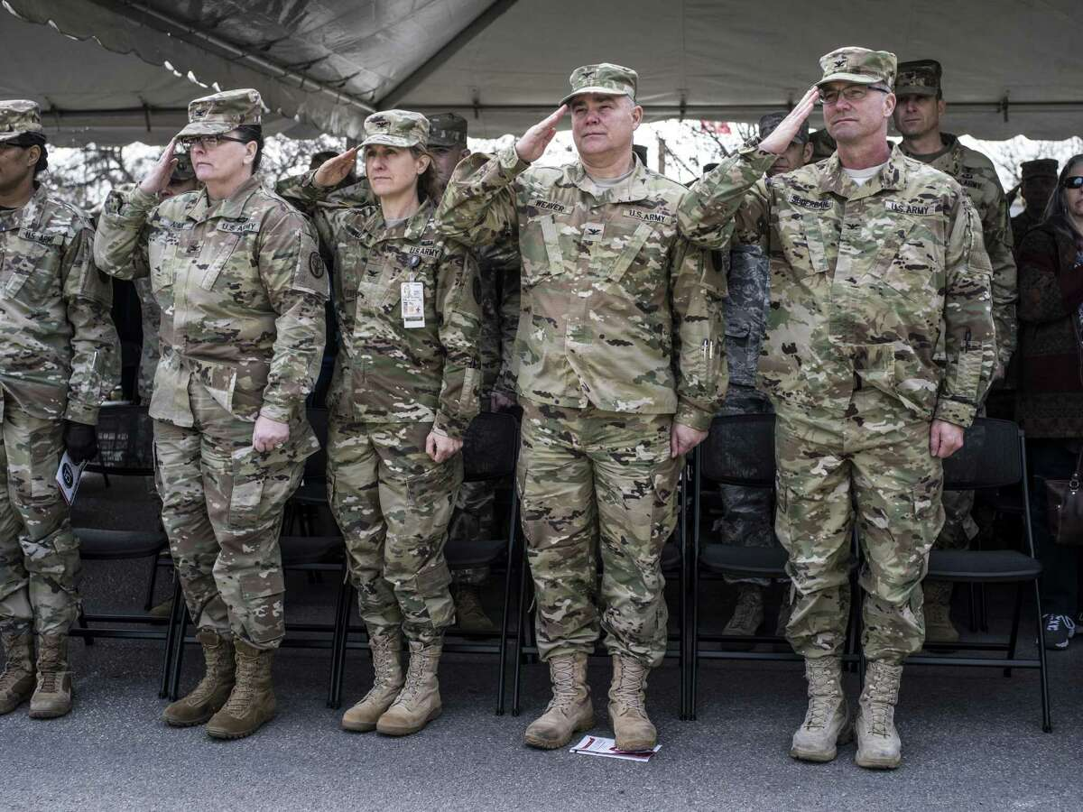 Army soldiers stand at attention during the playing of the National Anthem during the Center For the Intrepid's 10th year anniversary in San Antonio, Texas on Friday, January 27, 2017.