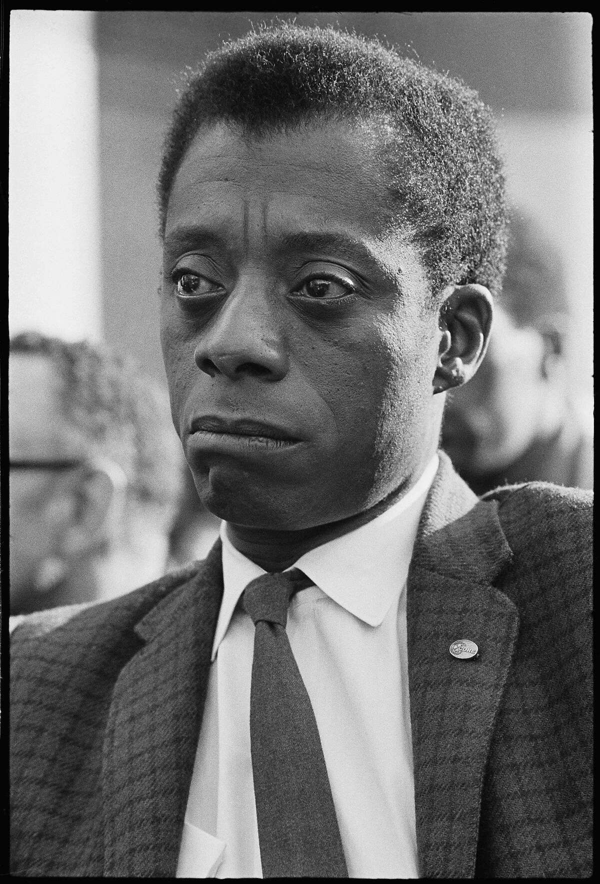 """This image released by Magnolia Pictures shows James Baldwin in """"I Am Not Your Negro."""" The film was nominated for an Oscar for best documentary feature on Tuesday, Jan. 24, 2017. The 89th Academy Awards will take place on Feb. 26. (Bob Adelman/Magnolia Pictures via AP)"""