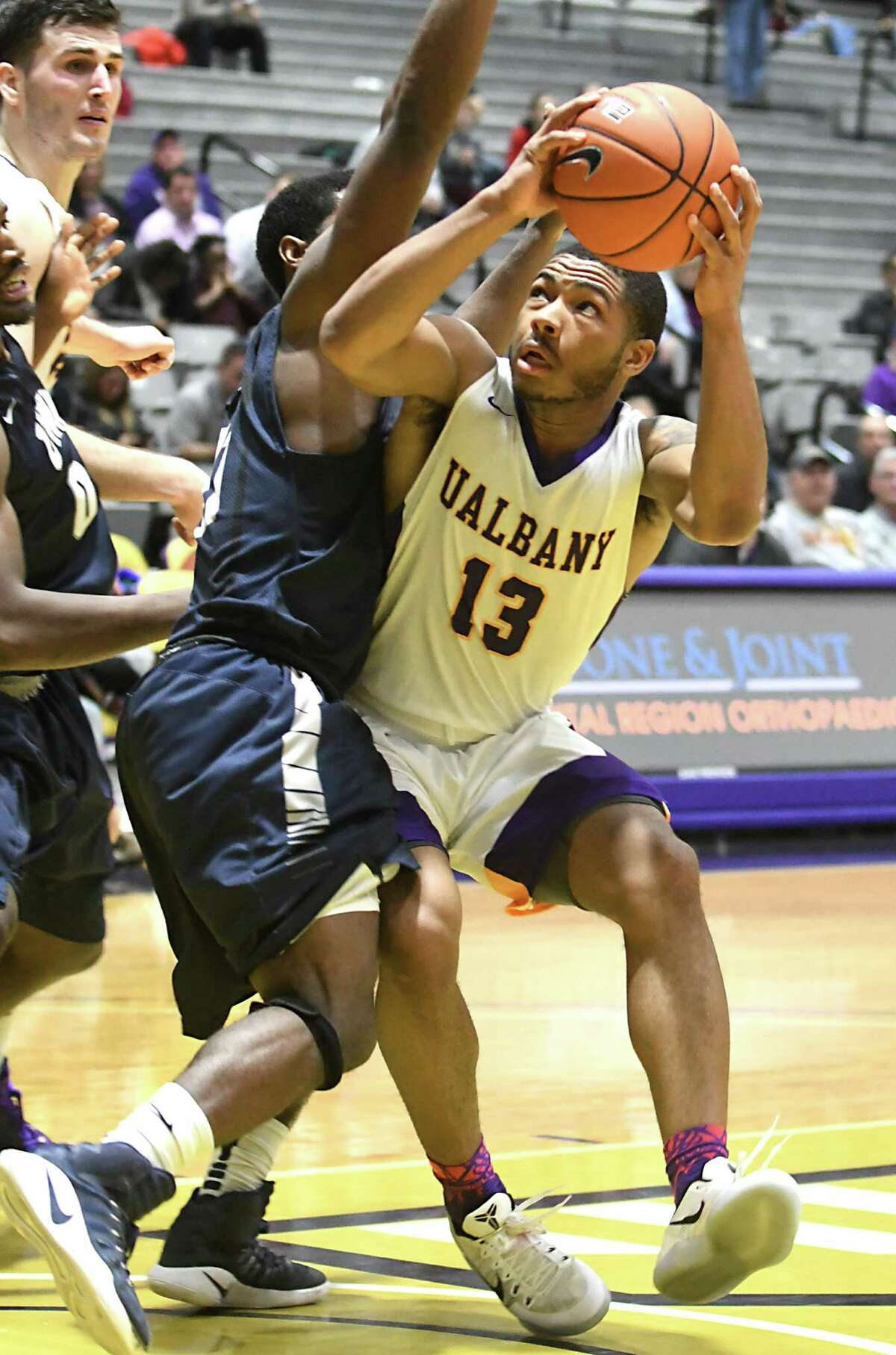 University at Albany's David Nichols is defended by New Hampshire's Jordan Reed during a basketball game at SEFCU Arena on Wednesday, Jan. 11, 2017 in Albany, N.Y. (Lori Van Buren / Times Union)
