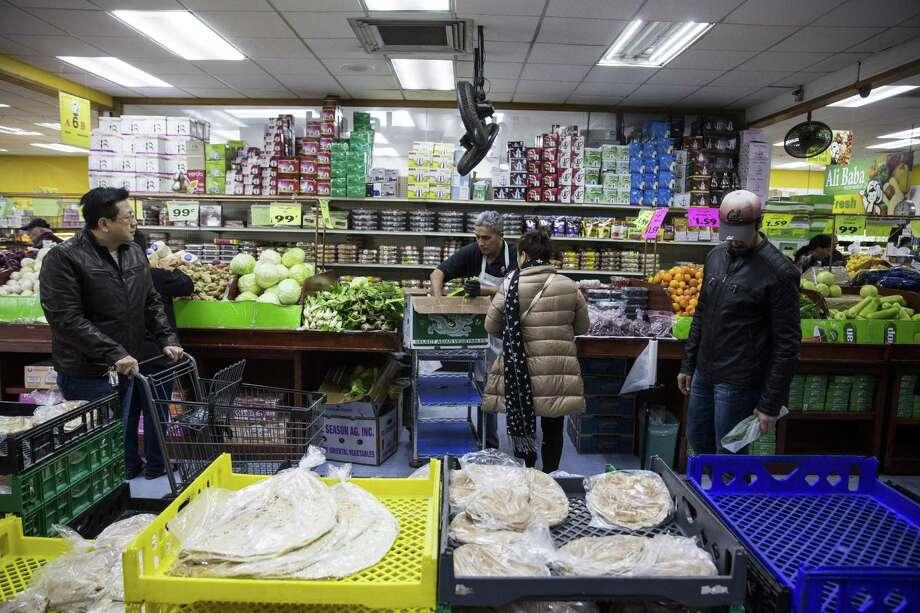 People shop at Ali Baba International Food Market in San Antonio, Texas on January 27, 2017. Photo: Photos By Carolyn Van Houten / San Antonio Express-News / 2017 San Antonio Express-News