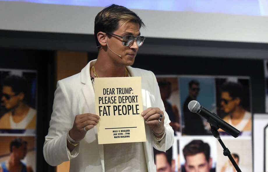 Milo Yiannopoulos holds a sign as he speaks at the University of Colorado campus in Boulder, Colo., Wednesday, Jan. 25, 2017. Yiannopoulos is an editor at the alt-right website Breitbart News. The alt-right is an offshoot of conservatism mixing racism, white nationalism and populism. (Jeremy Papasso/Daily Camera via AP) Photo: Jeremy Papasso, Associated Press