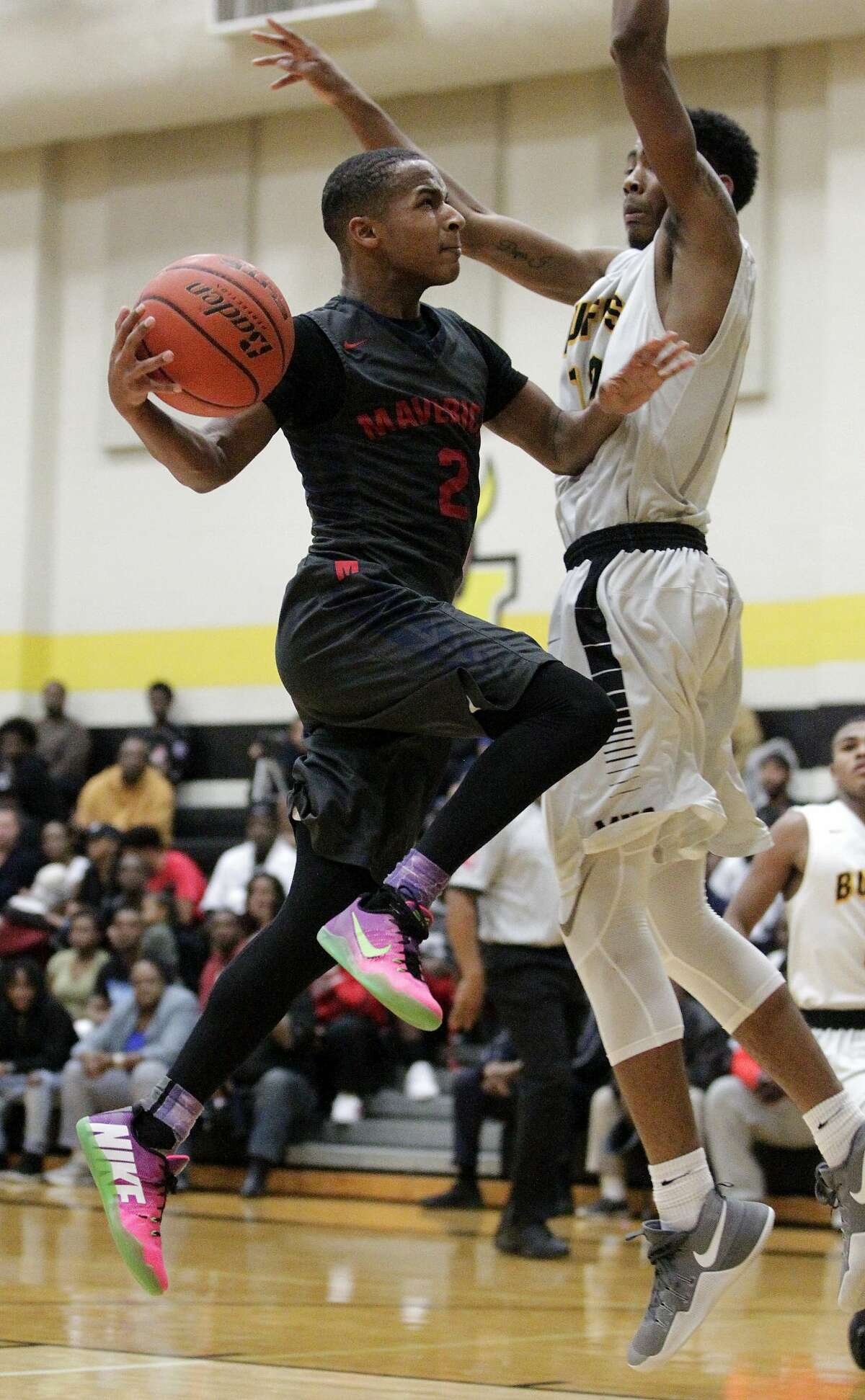 Manvel Vernice Seriale (2) drives to the basket as Fort Bend Marshall Tajzmel Sherman defends during a high school basketball game on Friday, Jan. 27, 2017, in Missouri City. ( J. Patric Schneider / For the Chronicle )