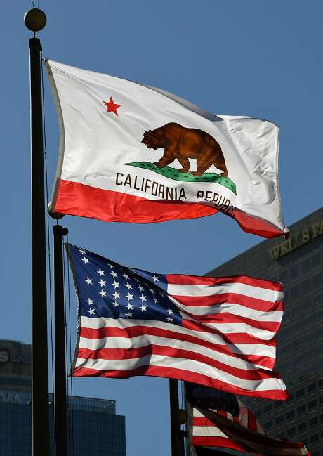 The California state flag flies outside City Hall in Los Angeles on Friday. Photo: MARK RALSTON, AFP/Getty Images