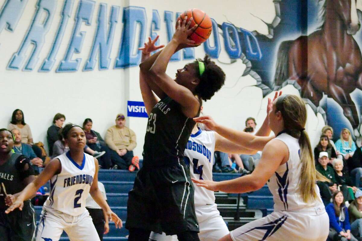 Clear Falls' Cortisha Elias (33) puts up a shot against Friendswood Friday, Jan. 24 at Friendswood High School.
