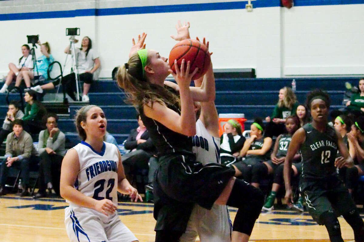 Clear Falls' Madison Nicholas (1) drives to the basket past Friendswood's Emily Lord (11) Friday, Jan. 24 at Friendswood High School.