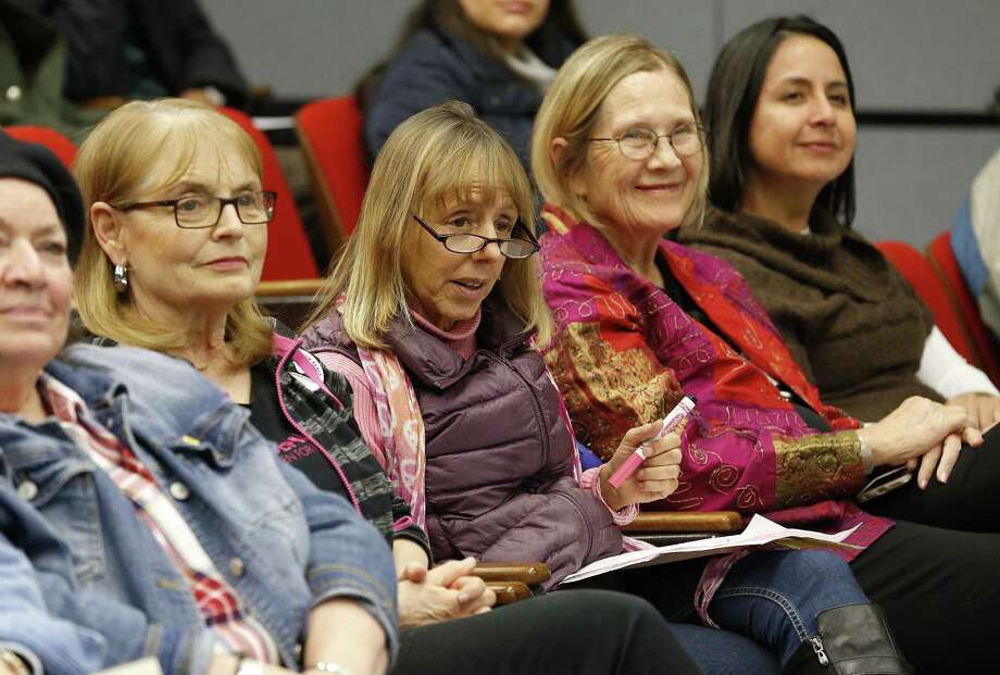 Medea Benjamin (center), co-founder of the women-led peace group CODEPINK and the international human rights group Global Exchange, and Ann Wright (right of Benjamin), a retired U.S. Army colonel and former diplomat who resigned from the U.S. State Department in protest of the invasion of Iraq, speak at the University of the Incarnate Word on Friday night about foreign policy in the Trump era. (Kin Man Hui/San Antonio Express-News) Photo: Kin Man Hui, Staff / San Antonio Express-News / ©2017 San Antonio Express-News