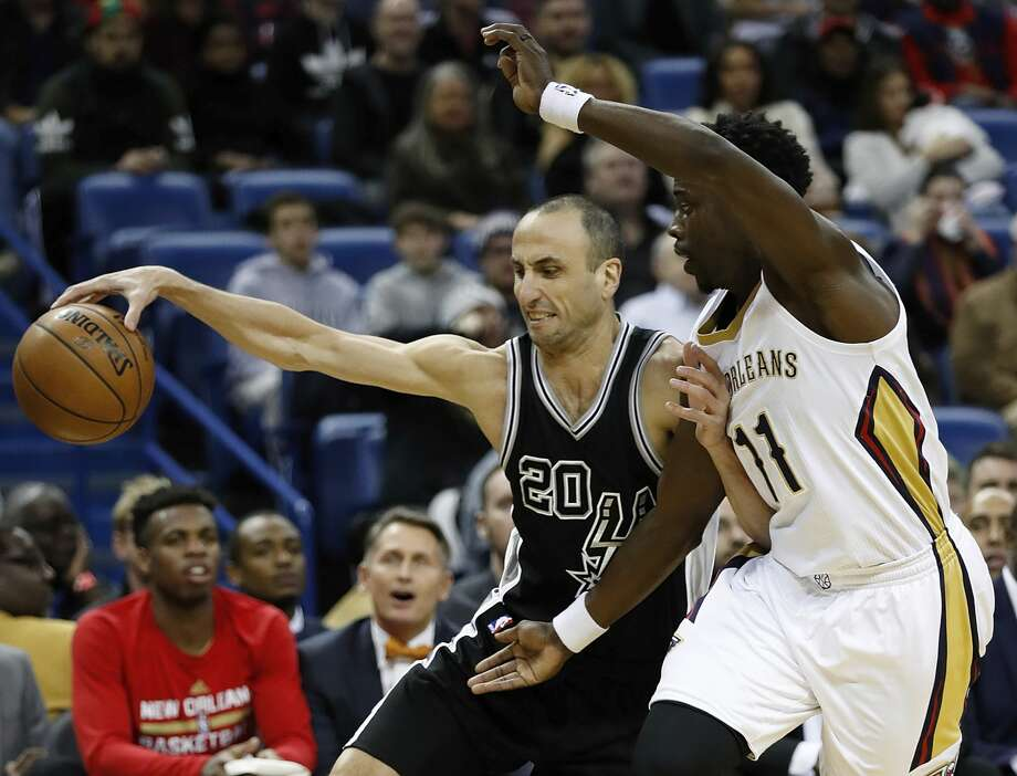 San Antonio Spurs guard Manu Ginobili (20) is guarded New Orleans Pelicans guard Jrue Holiday (11) during the first half of an NBA basketball game in New Orleans, Friday, Jan. 27, 2017. (AP Photo/Tyler Kaufman) Photo: Tyler Kaufman/Associated Press