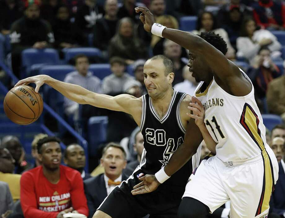 San Antonio Spurs guard Manu Ginobili (20) is guarded New Orleans Pelicans guard Jrue Holiday (11) during the first half of an NBA basketball game in New Orleans, Friday, Jan. 27, 2017. (AP Photo/Tyler Kaufman) Photo: Tyler Kaufman, FRE / Associated Press / FR 170517AP