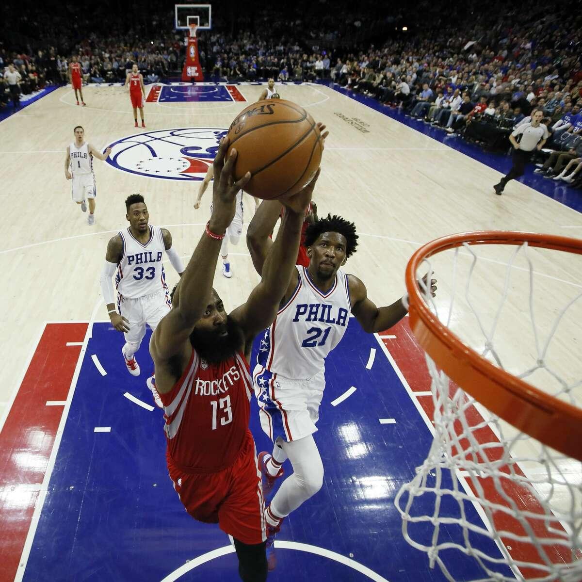 Houston Rockets' James Harden (13) goes up for a dunk against Philadelphia 76ers' Joel Embiid (21) during the second half of an NBA basketball game, Friday, Jan. 27, 2017, in Philadelphia. Houston won 123-118. (AP Photo/Matt Slocum)