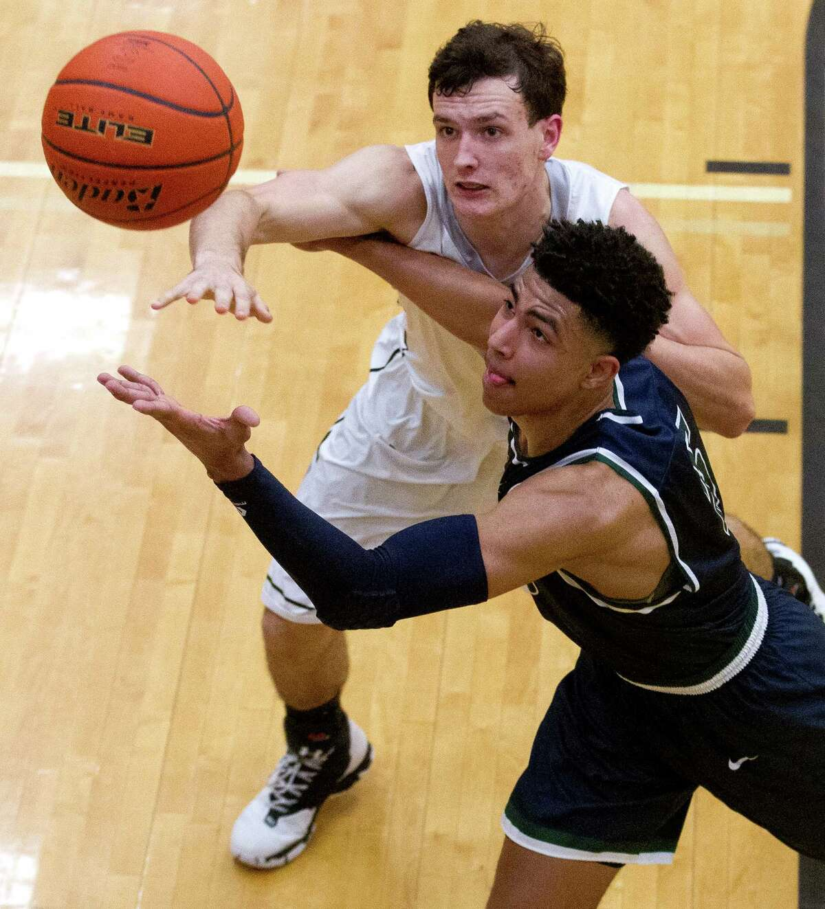 Conroe forward Joshua Berry (44) and College Park guard Quentin Grimes (5) go for a loose ball during the second quarter of a District 16-6A high school boys basketball game at Conroe High School Friday, Jan. 27, 2017, in Conroe. Conroe defeated College Park 82-65.