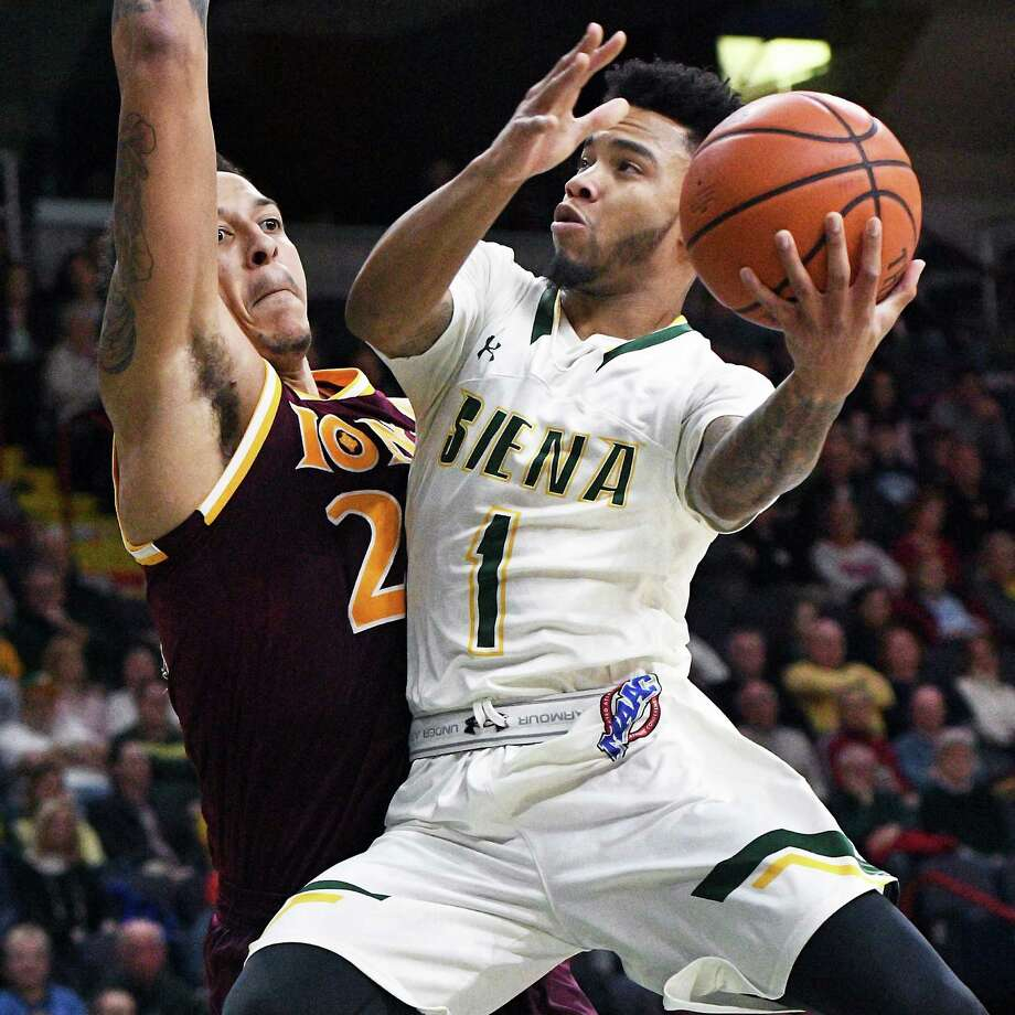Siena's #1Marquis Wright, right, goes up for two points defended by Iona's #22 Taylor Bessick during Friday's game at the Times Union Center Jan. 27, 2017 in Albany, NY.  (John Carl D'Annibale / Times Union) Photo: John Carl D'Annibale / 20039267A