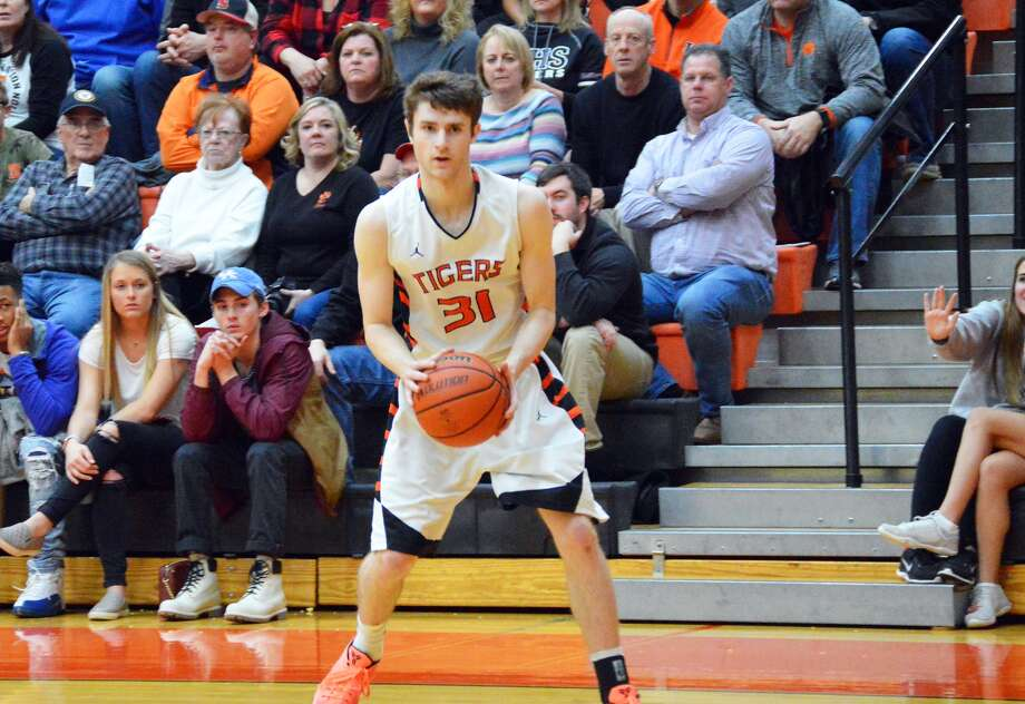 Edwardsville senior guard Oliver Stephen eyes up a 3-pointer in the fourth quarter. Stephen hit the shot to eclipse 1,000 career points.