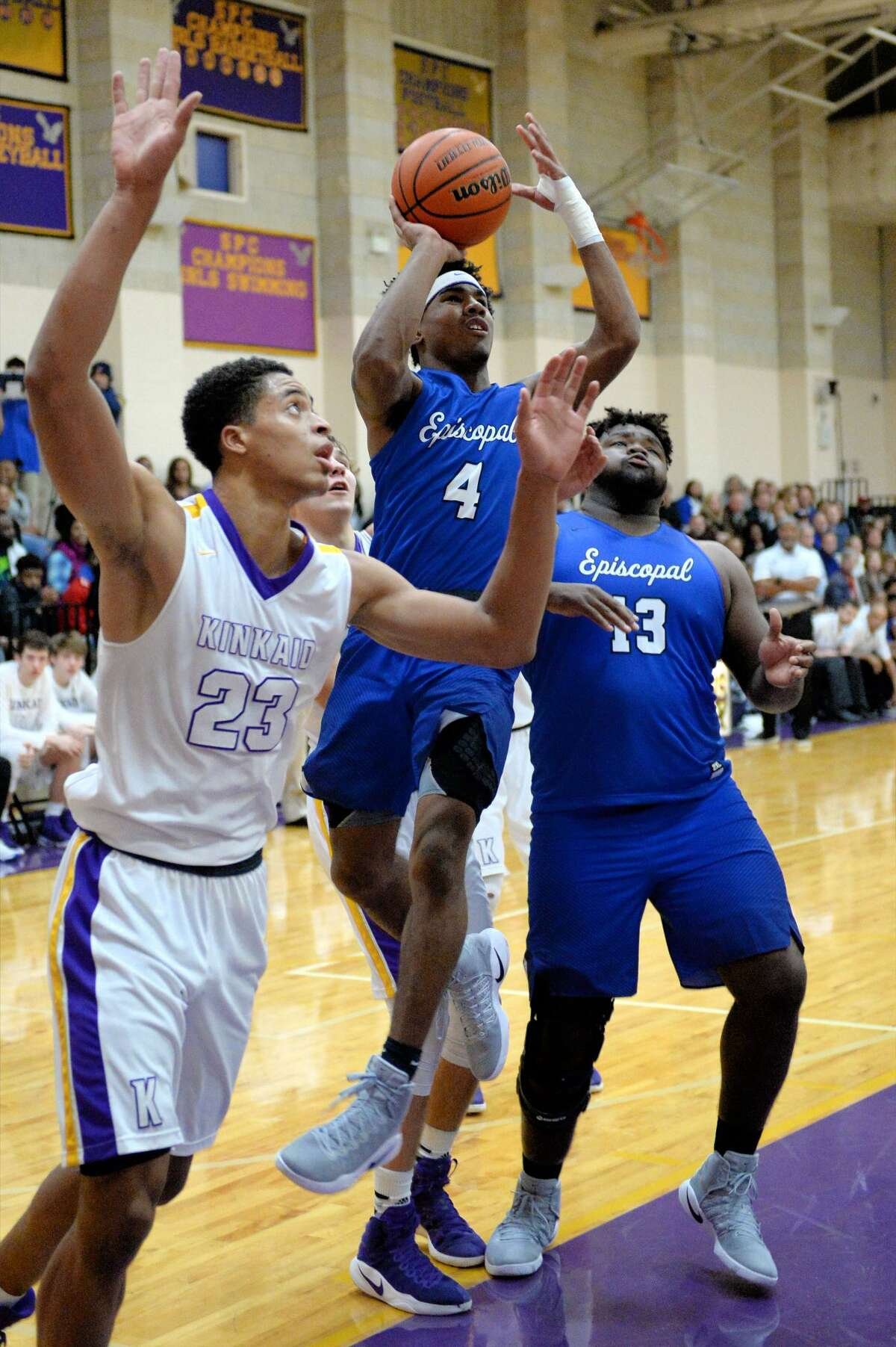 Jaylen Waddle (4) of Episcopal attempts a jump shot during the first half of a boys basketball game between the Episcopal Knights and the Kinkaid Falcons on Tuesday January 27, 2017 at Kinkaid High School, Houston, TX.
