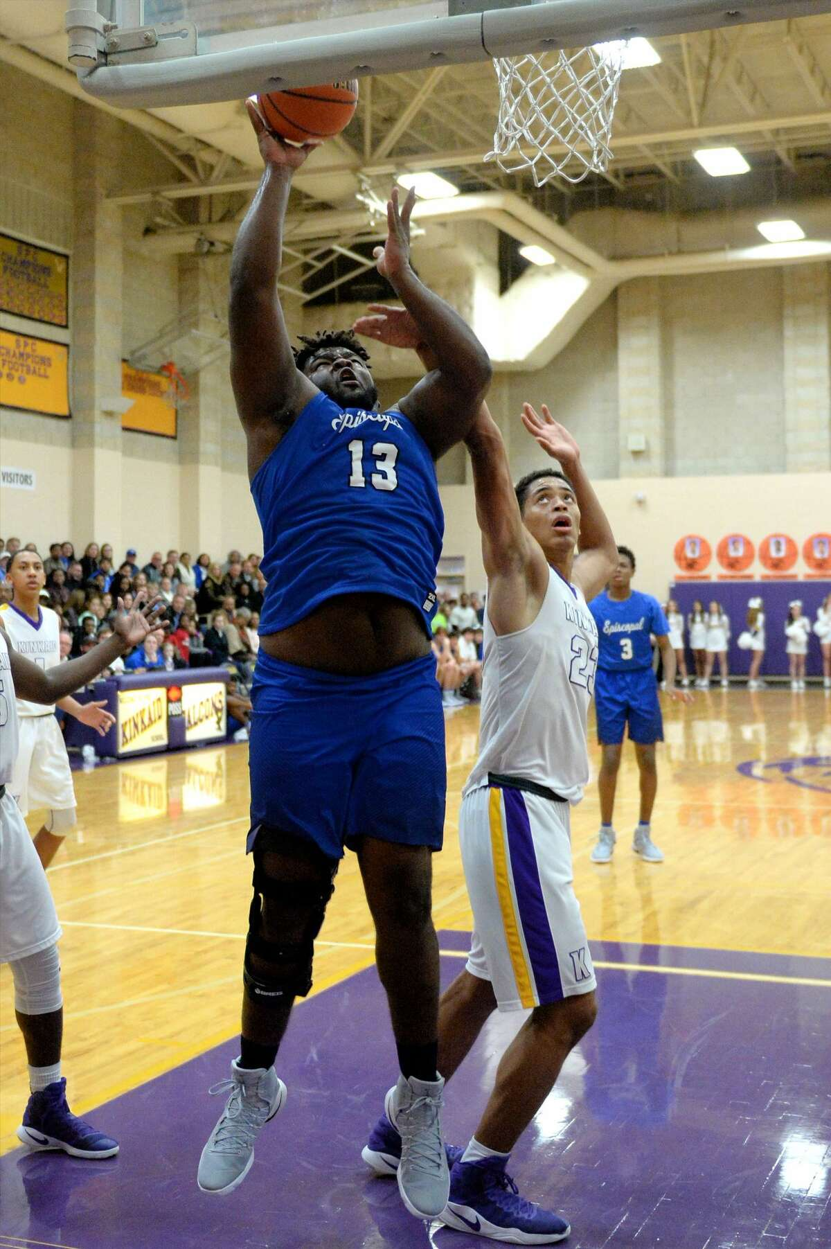 Marvin Wilson (13) of Episcopal attempts a lay-up during the first half of a boys basketball game between the Episcopal Knights and the Kinkaid Falcons on Tuesday January 27, 2017 at Kinkaid High School, Houston, TX.