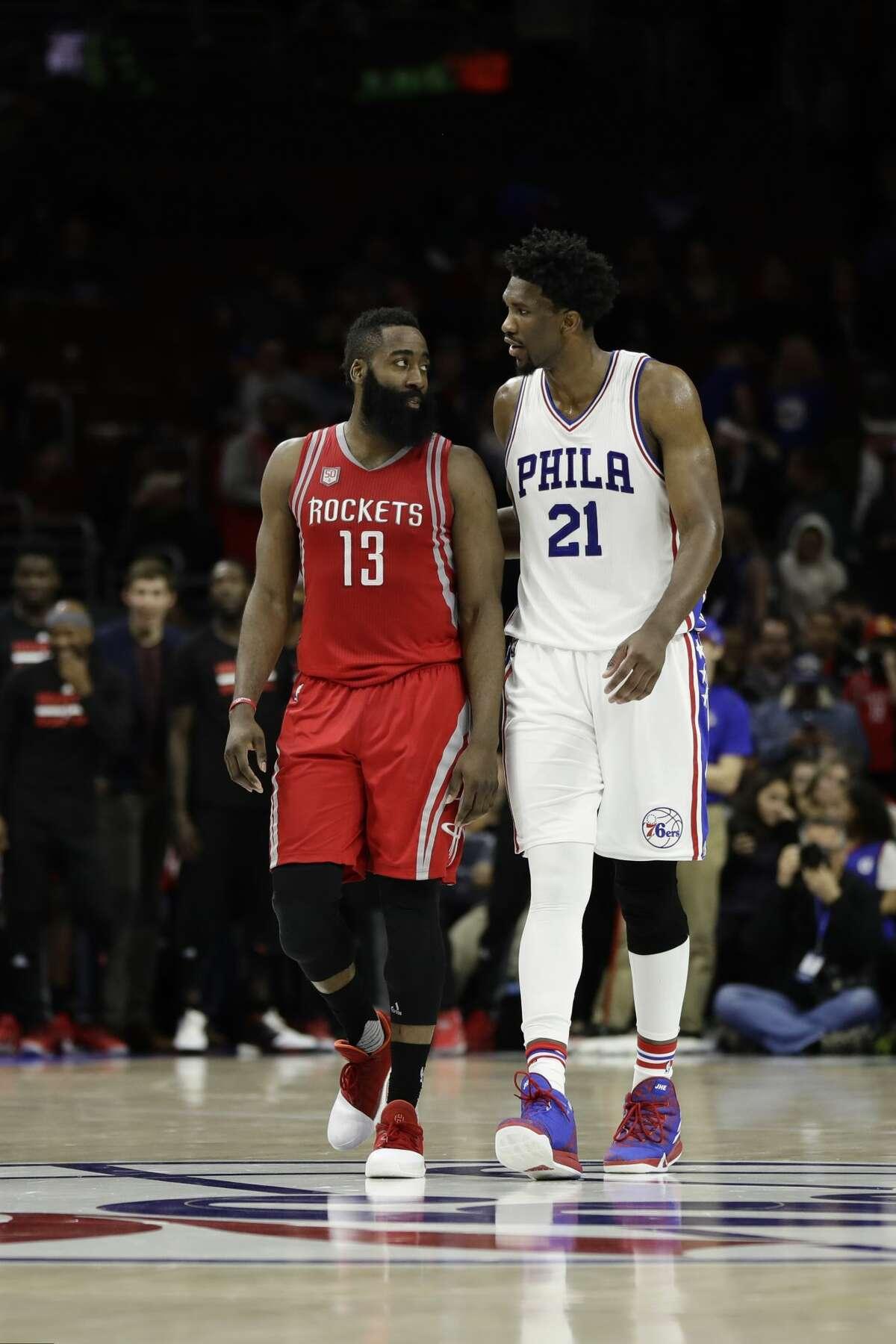 Houston Rockets' James Harden, left, and Philadelphia 76ers' Joel Embiid walk down the court during an NBA basketball game, Friday, Jan. 27, 2017, in Philadelphia. (AP Photo/Matt Slocum)