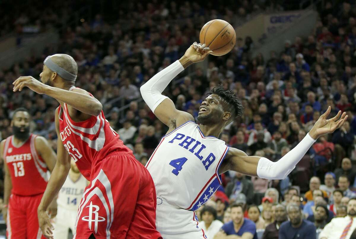The Philadelphia 76ers' Nerlens Noel (4) loses the ball after getting fouled against the Houston Rockets' Corey Brewer during the third quarter on Friday, Jan. 27, 2017, at the Wells Fargo Center in Philadelphia. The Rockets won, 123-118. (Yong Kim/Philadelphia Daily News/TNS)