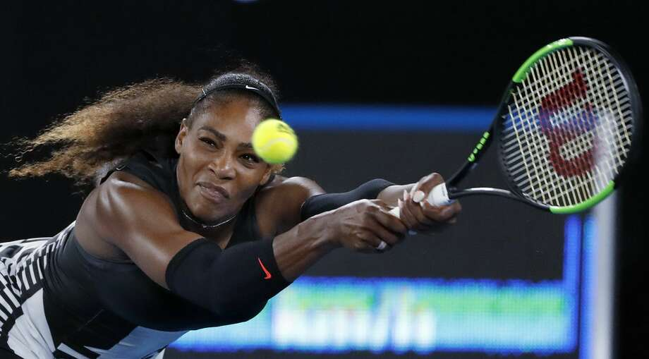 United States' Serena Williams reaches for a a backhand to her sister, Venus, during the women's singles final at the Australian Open tennis championships in Melbourne, Australia, Saturday, Jan. 28, 2017. (AP Photo/Dita Alangkara) Photo: Dita Alangkara/Associated Press