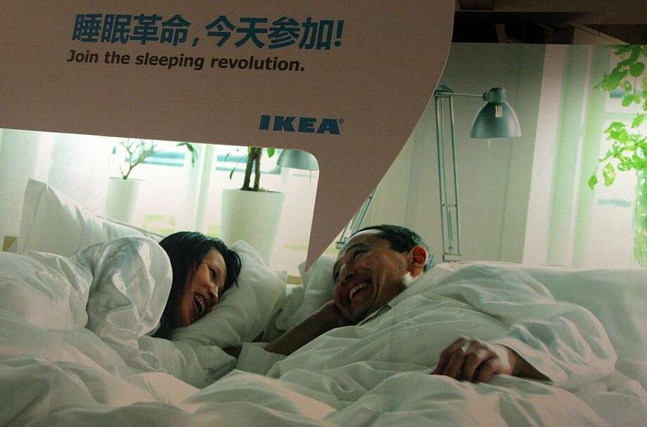 Shoppers test a bed at Ikealand in Shanghai. In China, IKEA is not only a place for shopping but also place to play. go on dates, and even sleep. Photo: Getty Images, Olivier Chouchana/Gamma-Rapho / 2011 Gamma-Rapho