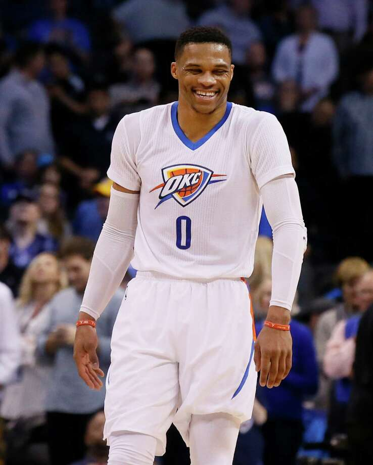 Oklahoma City Thunder guard Russell Westbrook (0) laughs in the fourth quarter of an NBA basketball game against the Dallas Mavericks in Oklahoma City, Thursday, Jan. 26, 2017. Oklahoma City won 109-98. (AP Photo/Sue Ogrocki) Photo: Sue Ogrocki, Associated Press / AP2017