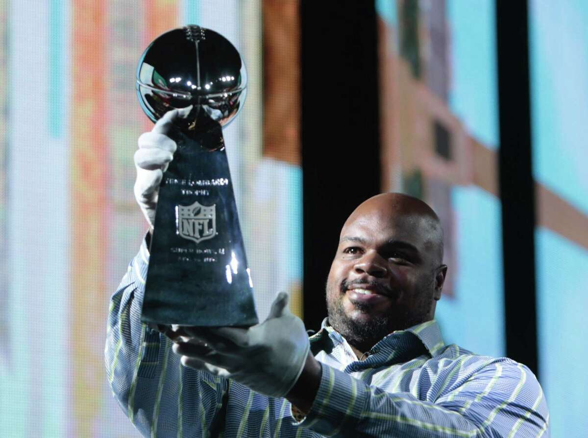 Houston Texans nose tackle Vince Wilfork delivers the Vince Lombardi Trophy to the NFL Experience on Saturday, Jan. 28, 2017, in Houston.