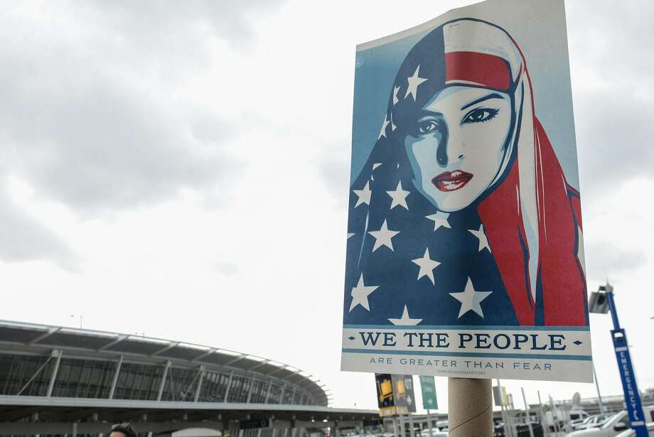 NEW YORK, NY - JANUARY 28: Protestors rally  during a protest against the Muslim immigration ban at John F. Kennedy International Airport on January 28, 2017 in New York City. President Trump singed the controversial executive order that halted refugees and residents from predominantly Muslim countries from entering the United States. (Photo by Stephanie Keith/Getty Images) Photo: Stephanie Keith, Getty Images