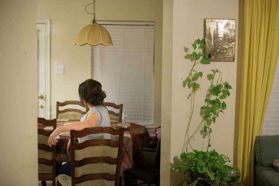 The wife of an Iraqi national who was detained at the John F. Kennedy International Airport, at her sister's home in Houston, Jan. 28, 2017. President Donald Trump enacted an order Friday that blocks entry into the country for citizens of seven predominantly Muslim countries, including Iraq. (Michael Stravato/The New York Times) Photo: MICHAEL STRAVATO, NYT / NYTNS