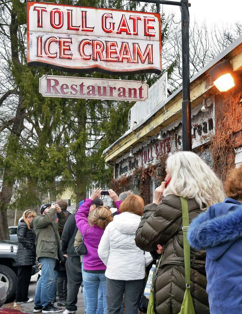 Loyal customers line up as Toll Gate Ice Cream gives away free ice cream as a thank you for their support of the its ailing owner Rob Zautner, Saturday Jan. 28, 2017 in Slingerlands, NY. Family members remind the public that their closing will only by temporary. (John Carl D'Annibale / Times Union)