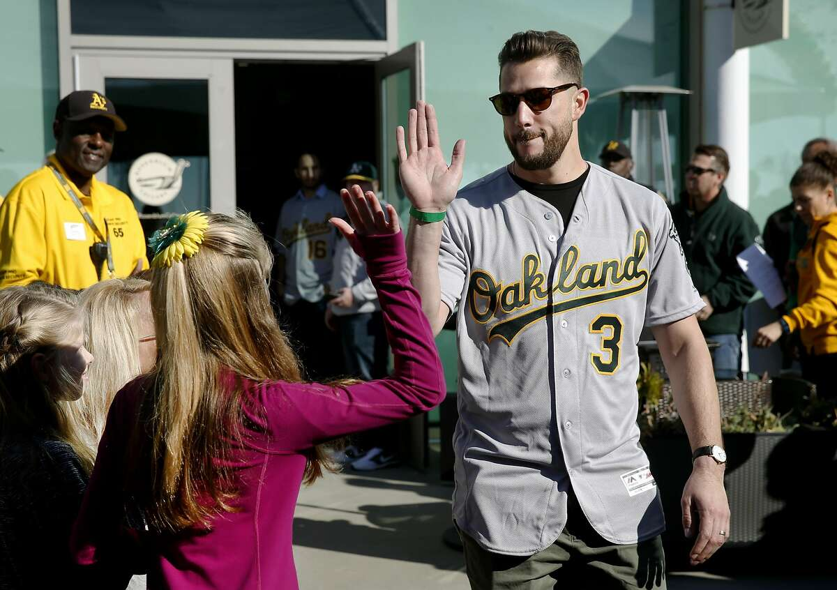 New third baseman Trevor Plouffe greets fans as he's introduced at the Oakland A's FanFest celebration on Jack London Square in Oakland, Calif. on Saturday, Jan. 28, 2017.