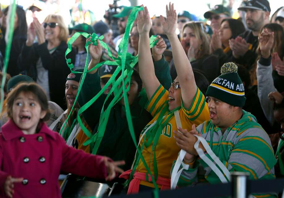 Fans celebrate the introduction of the team at the 2017 A's FanFest at Jack London Square. Photo: Paul Chinn / The Chronicle