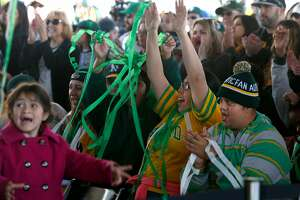 Streamers rain down on fans after this season's team is introduced at the Oakland A's FanFest celebration on Jack London Square in Oakland, Calif. on Saturday, Jan. 28, 2017.