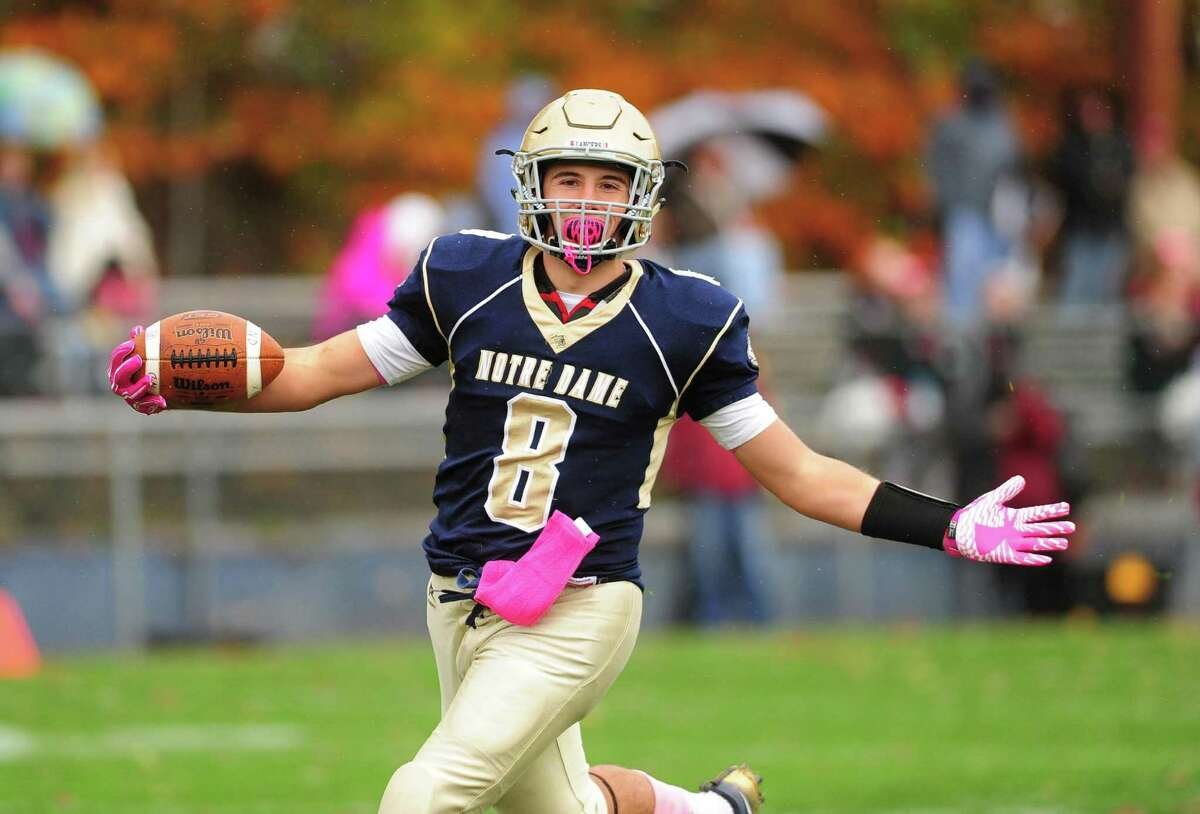 Notre Dame of Fairfield's Mike Bevino scores a touchdown during high school football action against Bethel in Fairfield, Conn. on Saturday Oct. 22, 2016.