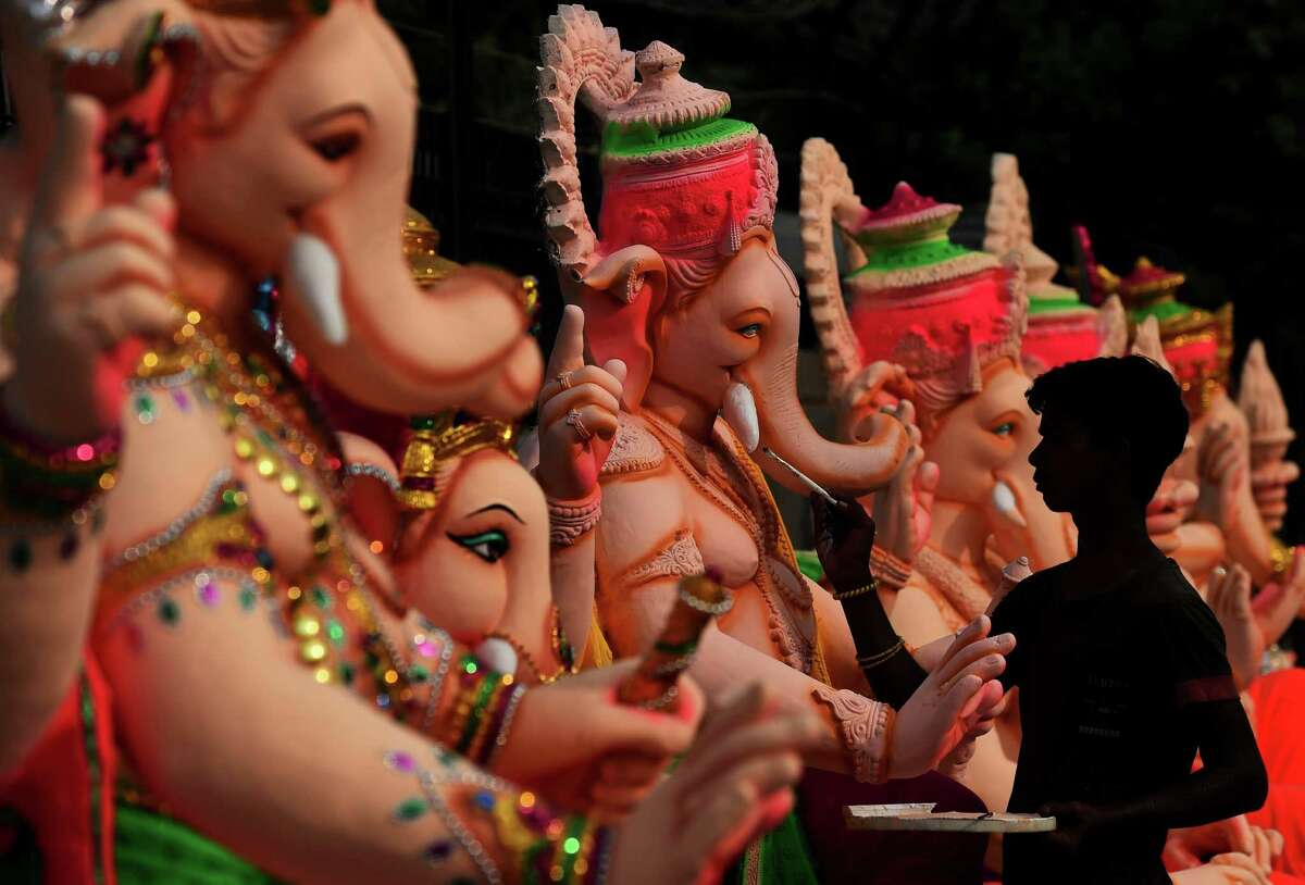 Festivals worshiping Ganesha originated in the Indian City of Prune more than 100 years ago. Here an Indian artist gives the finishing touches to a figure of the elephant-headed Hindu god Ganesha at a workshop ahead of the Ganesh Chaturthi festival in New Delhi on September 15, 2015. AFP PHOTO / SAJJAD HUSSAINSAJJAD HUSSAIN/AFP/Getty Images