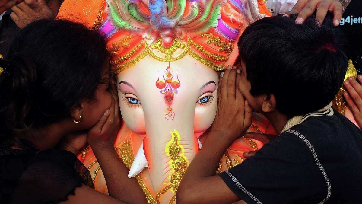 The deity's big ears big ears signify the importance of listening, its trunk represents taking only the good and not the bad and its small eyes encourage focus. Here Indian Hindu devotees whisper their wishes into the ear of an idol of elephant-headed Hindu god Ganesha during a ritual before immersion at the iconic Juhu Chowpatty beach on the fifth day of the eleven-day long festival Ganesh Chaturthi, in Mumbai on September 23, 2012. Hindu devotees bring home idols of Lord Ganesha in order to invoke his blessings for wisdom and prosperity. The eleven day Ganesh Festival sees millions of Hindus gathering along the western city's coast to immerse the elephant-god idols in the Arabian sea. AFP PHOTO/INDRANIL MUKHERJEEINDRANIL MUKHERJEE/AFP/GettyImages