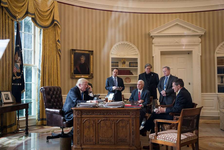 *** BESTPIX *** WASHINGTON, DC - JANUARY 28: President Donald Trump speaks on the phone with Russian President Vladimir Putin in the Oval Office of the White House, January 28, 2017 in Washington, DC. Also pictured, from left, White House Chief of Staff Reince Priebus, Vice President Mike Pence, White House Chief Strategist Steve Bannon, Press Secretary Sean Spicer and National Security Advisor Michael Flynn. On Saturday, President Trump is making several phone calls with world leaders from Japan, Germany, Russia, France and Australia. (Photo by Drew Angerer/Getty Images) Photo: Drew Angerer