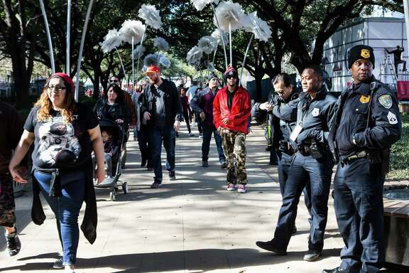 Houston Police officers stand together at while patroling at Super Bowl Live at Discovery Green on Saturday, Jan. 28, 2017, in Houston.