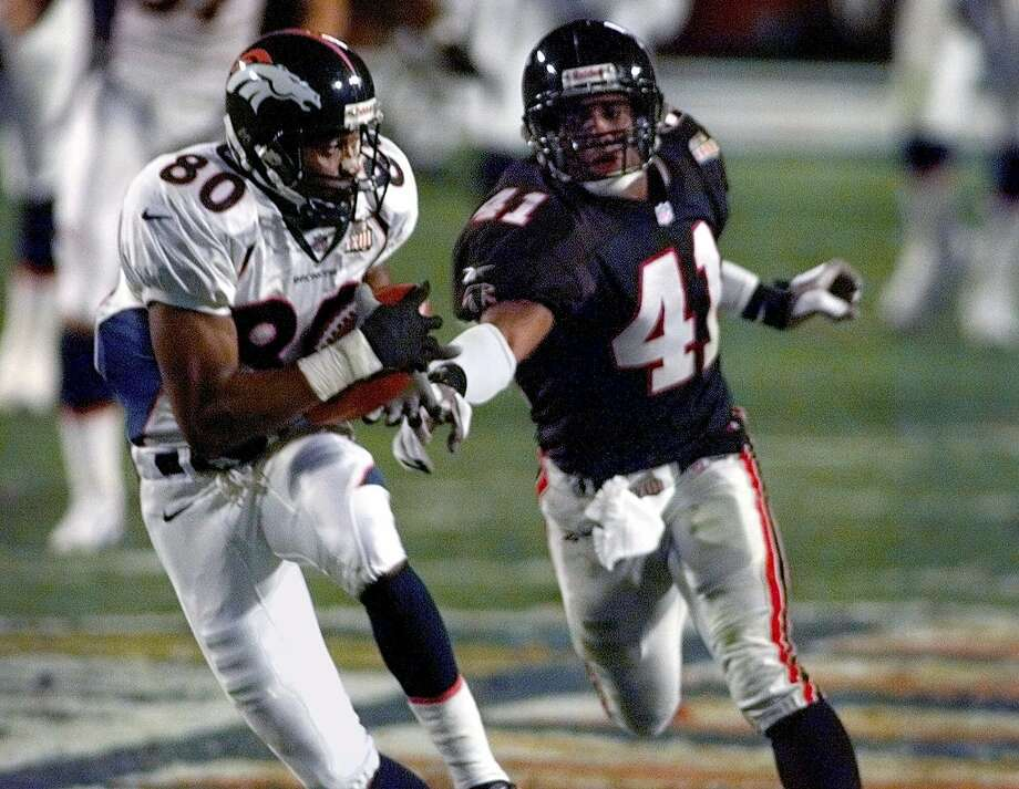 FILE - In this Jan. 31, 1999, file photo, Denver Broncos wide receiver Rod Smith (80) catches a pass for a touchdown as Atlanta Falcons saftey Eugene Robinson (41) moves in during the second quarter of Super Bowl XXXIII in Miami. The night before the game, Robinson was arrested for trying to solicit a prostitute. (AP Photo/Elise Amendola, File) Photo: ELISE AMENDOLA, Associated Pres / 1999 AP