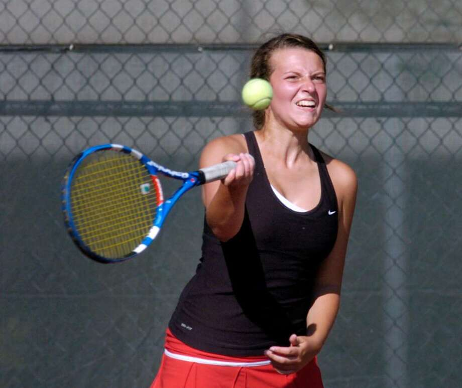 Emily Greene of New Canaan High School during her championship doubles match against Greenwich High School, at Wilton High School, Wednesday, May 26, 2010.  New Canaan won the FCIAC Championship over GHS, 5-2. Photo: Bob Luckey, ST / Stamford Advocate