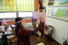Artist Janice Sweetwater works on completing a painting in her studio at the NEST Arts Factory in Bridgeport, Conn., on Saturday Jan. 28, 2017. Sweetwater and fellow artist Jane Davila are going to be holding an art class at the NEST Art Space scheduled for Feb. 11th and/or Feb. 25th from 2 - 5 p.m. For more details and other upcoming events, check out:  http://www.nestartsfactory.com/workshops