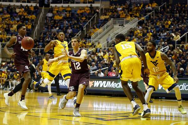 MORGANTOWN, WV - JANUARY 28:  Chris Collins #12 of the Texas A&M Aggies makes a pass under pressure against the West Virginia Mountaineers at the WVU Coliseum on January 28, 2017 in Morgantown, West Virginia.  (Photo by Justin K. Aller/Getty Images)