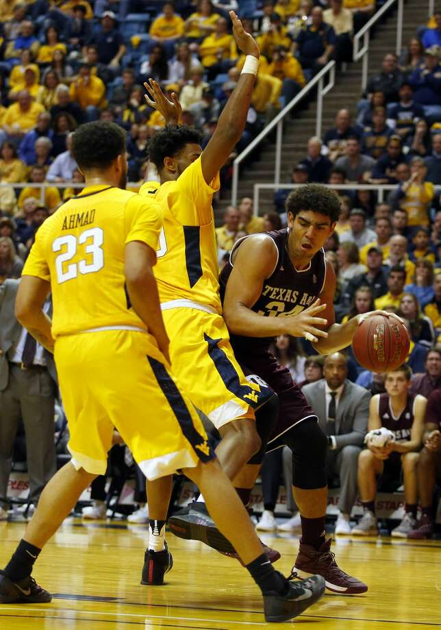 MORGANTOWN, WV - JANUARY 28:  Tyler Davis #34 of the Texas A&M Aggies dribbles along the baseline against the West Virginia Mountaineers at the WVU Coliseum on January 28, 2017 in Morgantown, West Virginia.  (Photo by Justin K. Aller/Getty Images) Photo: Justin K. Aller/Getty Images