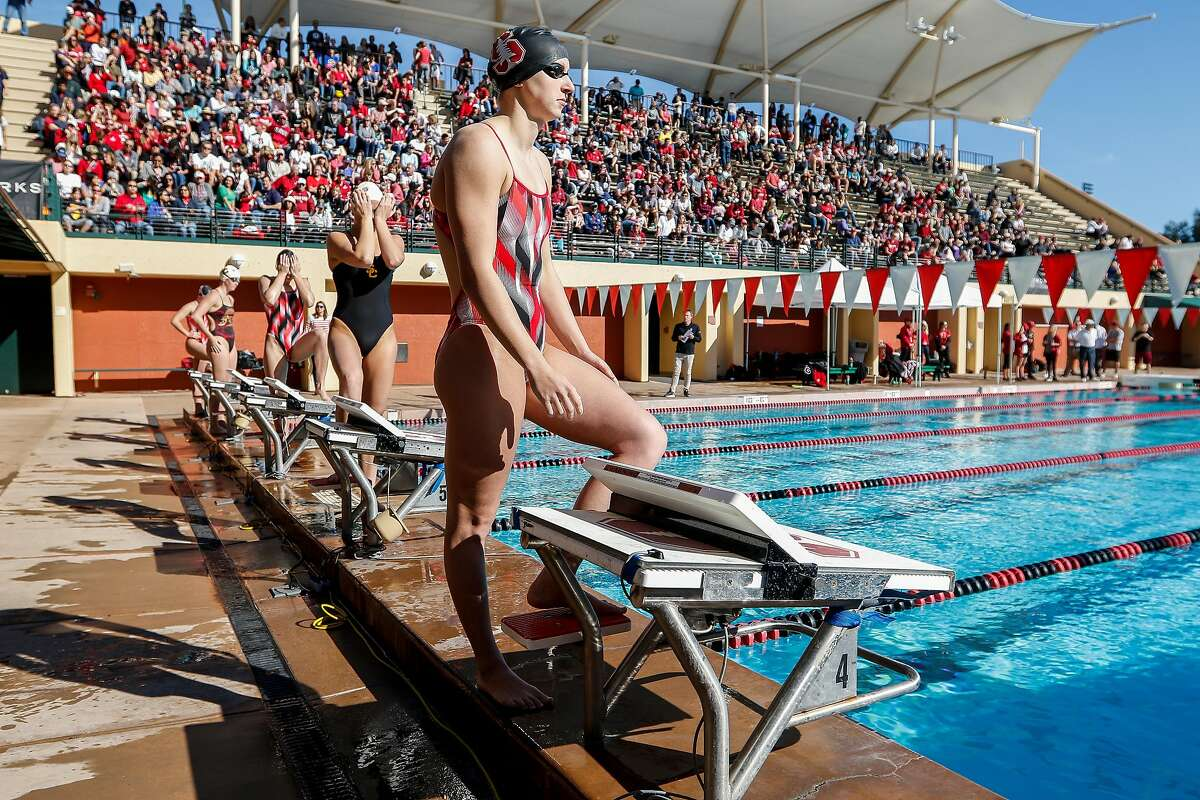 Stanford's Katie Ledecky prepares to swim in the Women's 500 Yard Freestyle during a swim meet against USC in front of a crowd at Avery Aquatic Center on Saturday, Jan. 28, 2017 in Stanford.