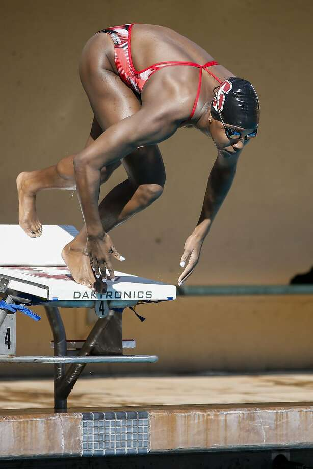 Sugar Land's Simone Manuel won a national title and set an NCAA record with her 21.17 time in the women's 50 freestyle at the NCAA Championships on Thursday in Indianapolis. Photo: Tony Avelar, Special To The Chronicle