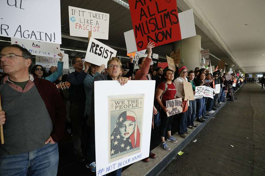 A crowd at S.F. International Airport protests the president's order, now blocked, banning travelers from Muslim countries. Photo: Paul Kuroda, Special To The Chronicle