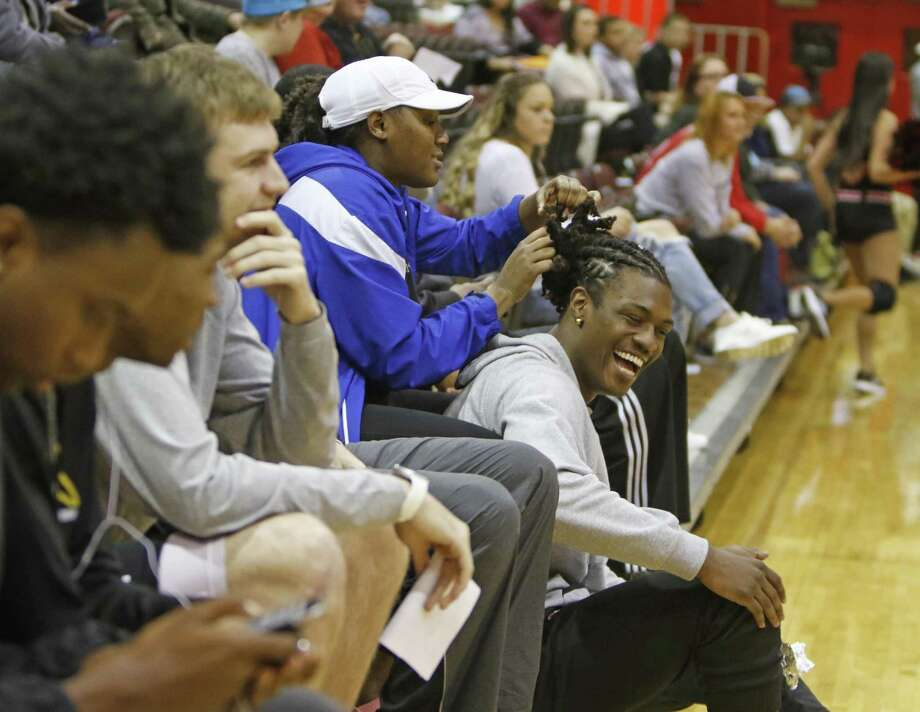 IWC's Miles Banks has his hair done by Bryaunea Hall prior to the stat of their game against Abliene Christian. UIW men's basketball game expose, an inside look at the Cardinals at UIW McDermott Convocation Center on Thursday, January 26, 2017. Photo: Ron Cortes, Freelance / For The San Antonio Express-News / Ronald Cortes / Freelance
