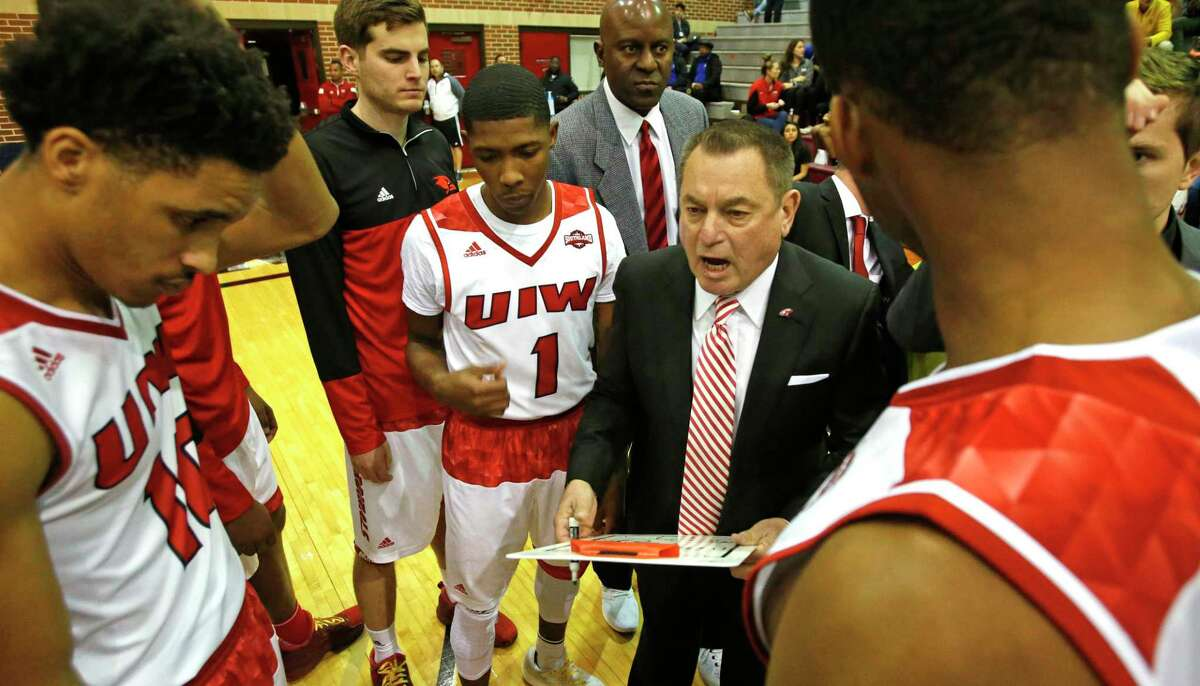 UIW head coach Ken Burmeister gives instruction before the start of their game against Abilene Christian on Jan. 26, 2017.