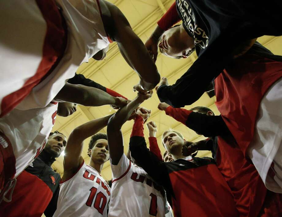 UIW players gather before the start of their game against Abilene Christian. UIW men's basketball game expose, an inside look at the Cardinals at UIW McDermott Convocation Center on Thursday, January 26, 2017. Photo: Ron Cortes, Freelance / For The San Antonio Express-News / Ronald Cortes / Freelance