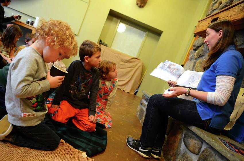 Kellin Castano, 4, of Hamden, drinks hot cocoa as Educator Katia Shortt reads to the children gathered for Winter Storytelling and Cocoa at the CT Audubon Society Center or Burr Street in Fairfield, Conn., on Saturday Jan. 28, 2017. The children along with theirfamilies got to listen to three books read by Shortt and were able to meet with several furry friends who stay at the center. For upcoming events like this one in Fairfield and in the rest of the state, go to the webpage: http://www.ctaudubon.org/#sthash.grvGXbSb.dpbs
