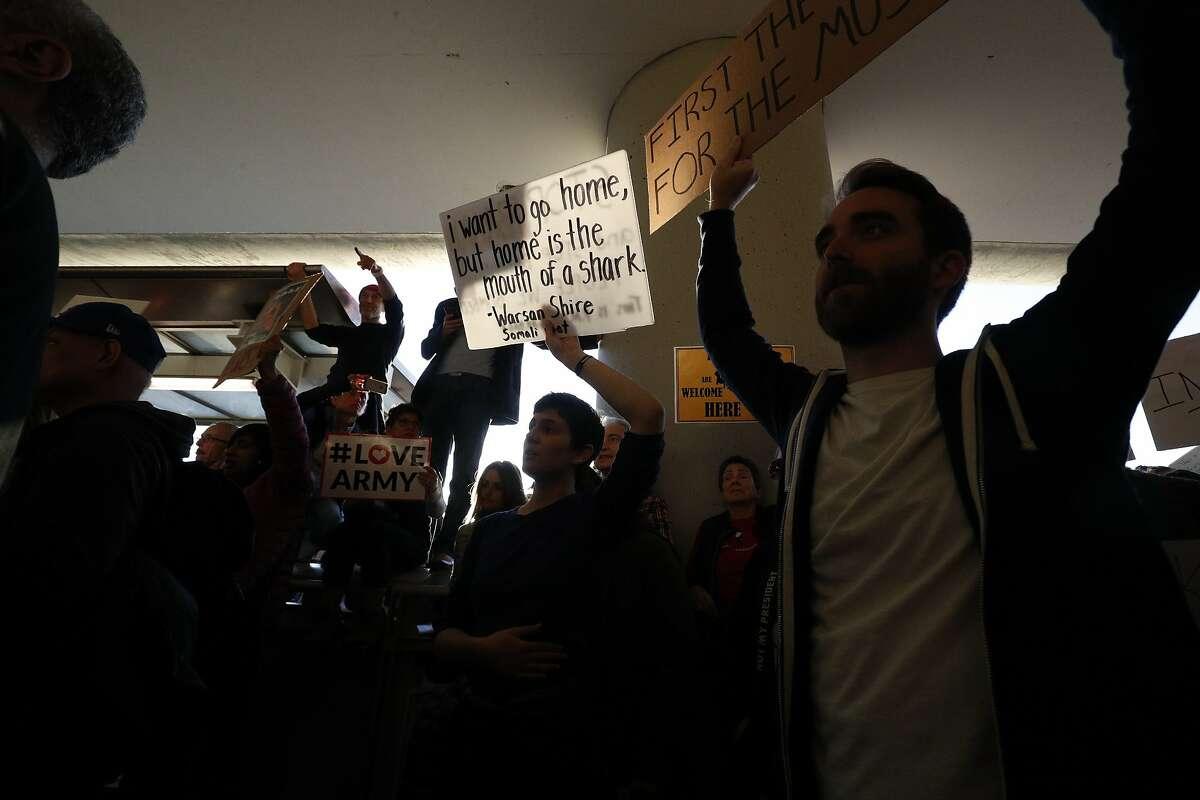 Protestors block arrival lower deck roadway on Saturday, Jan. 28, 2017 in San Francisco, Calif.